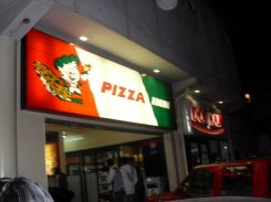 Late night rendezvous with local take-out spot, Pizza Inn on Samora Machel Ave